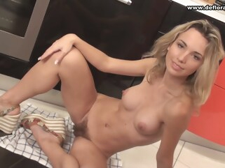 blonde A horny blonde is excited in the kitchen hairy hd